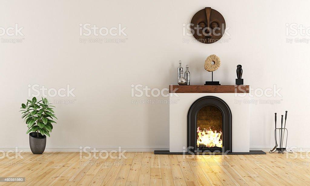 Empty room with minimalist fireplace stock photo
