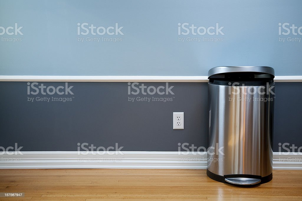 Empty Room With Modern Trash Can stock photo