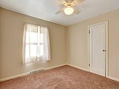 Empty room with soft brown carpet