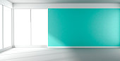 Empty room with turquoise wall and panoramic window