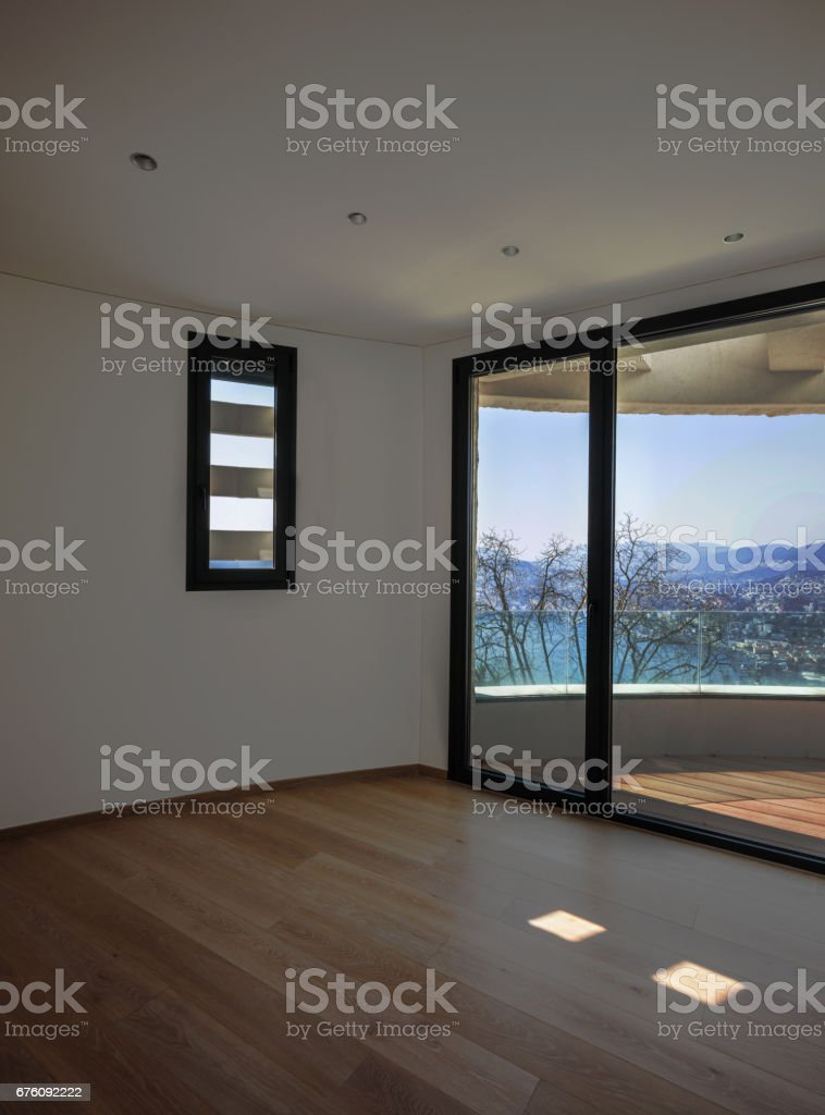 Empty room with wide window stock photo