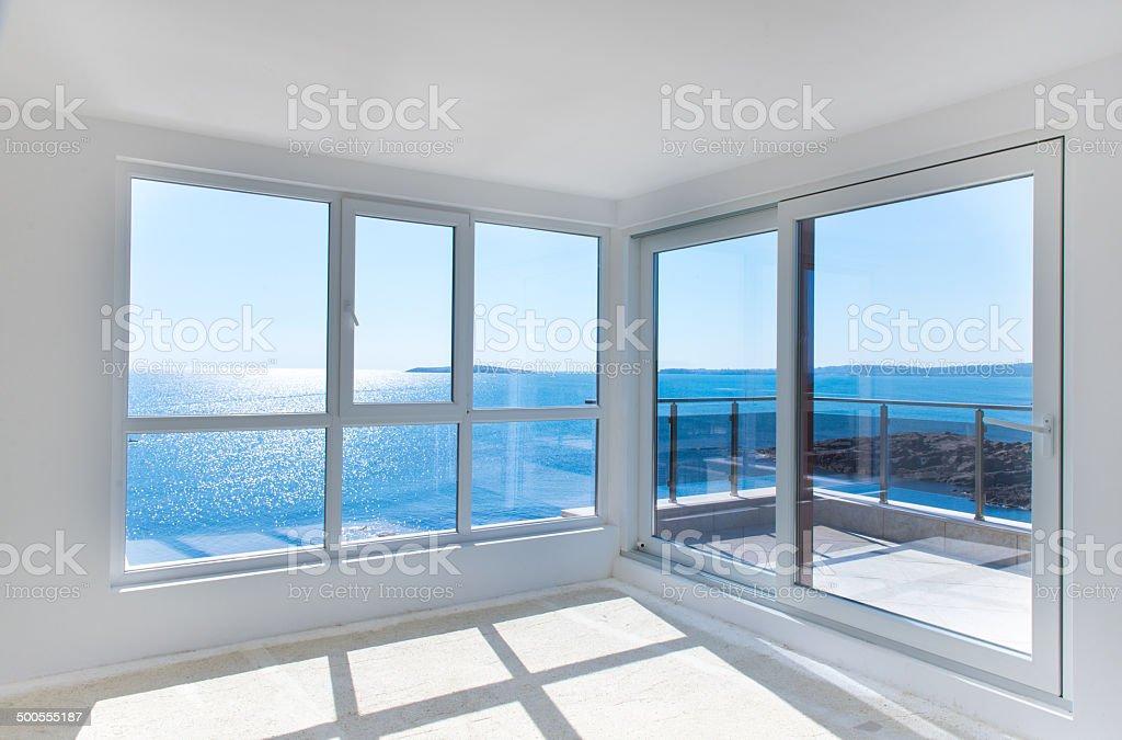 empty room with windows to sea stock photo