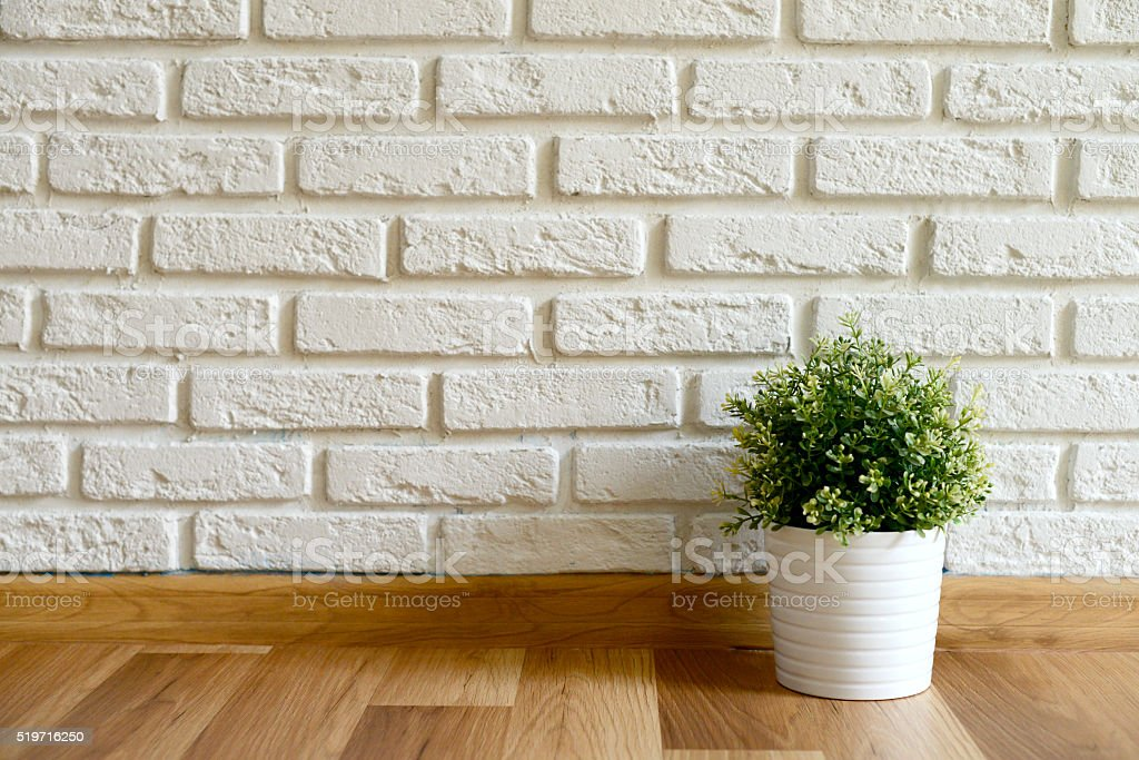 empty room with Wood Laminate Floor and Brick wall stock photo