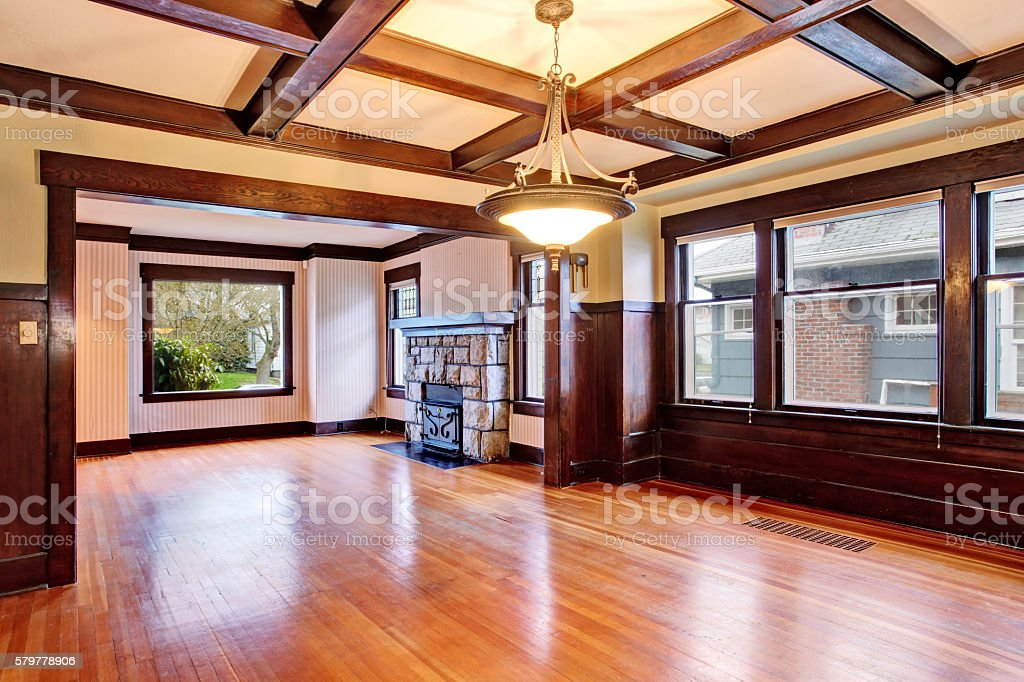 Empty room with wood paneled walls and coffered ceiling. stock photo