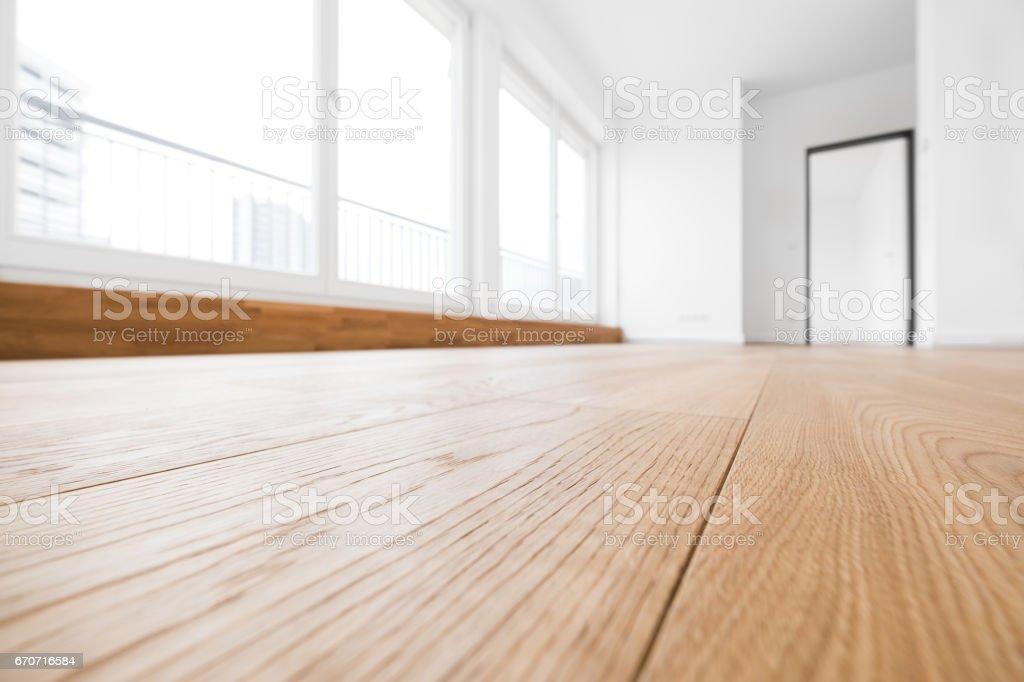 empty room, wooden floor in new apartment stock photo