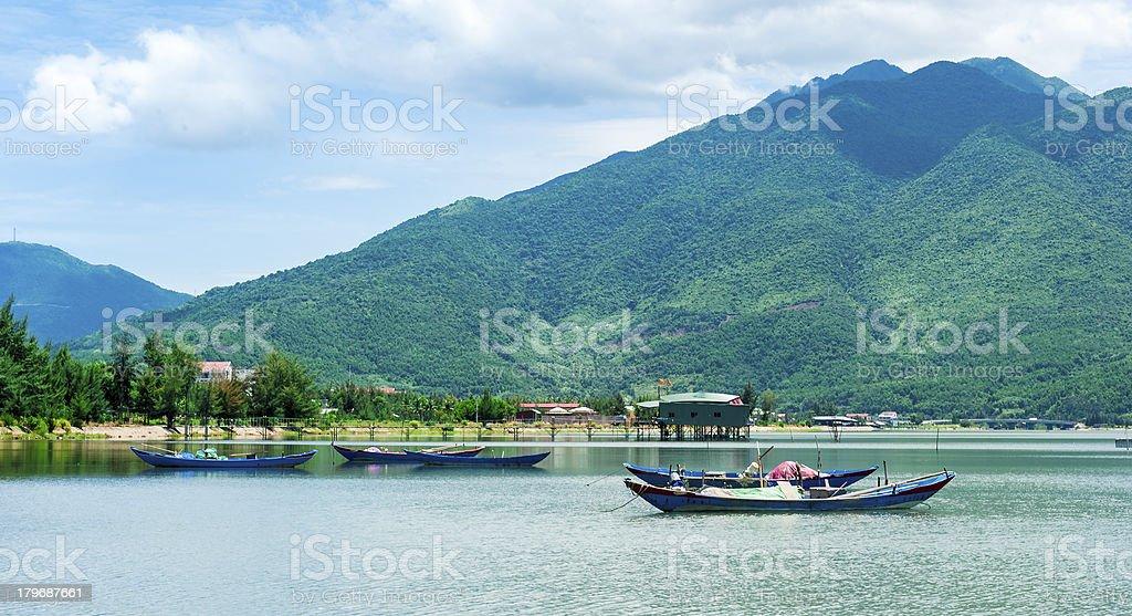 Empty rowboats on the lagoon in Hue City royalty-free stock photo