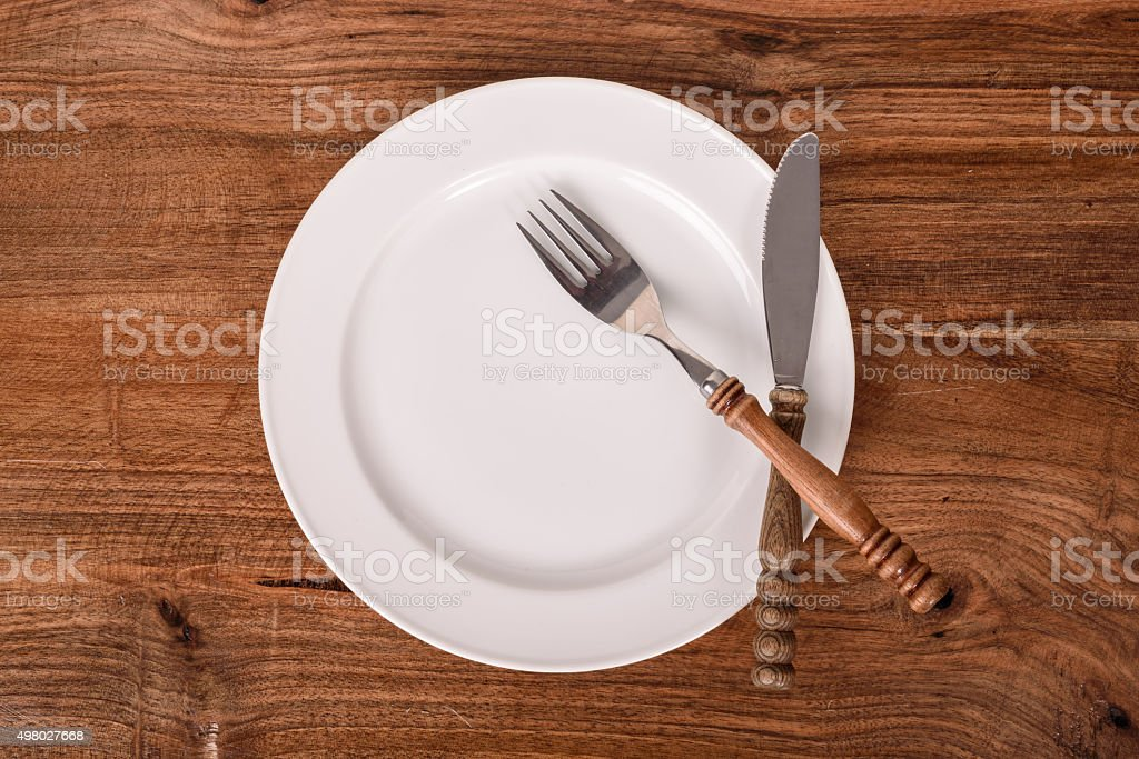 Empty Rustic Plate, Fork and Knife stock photo