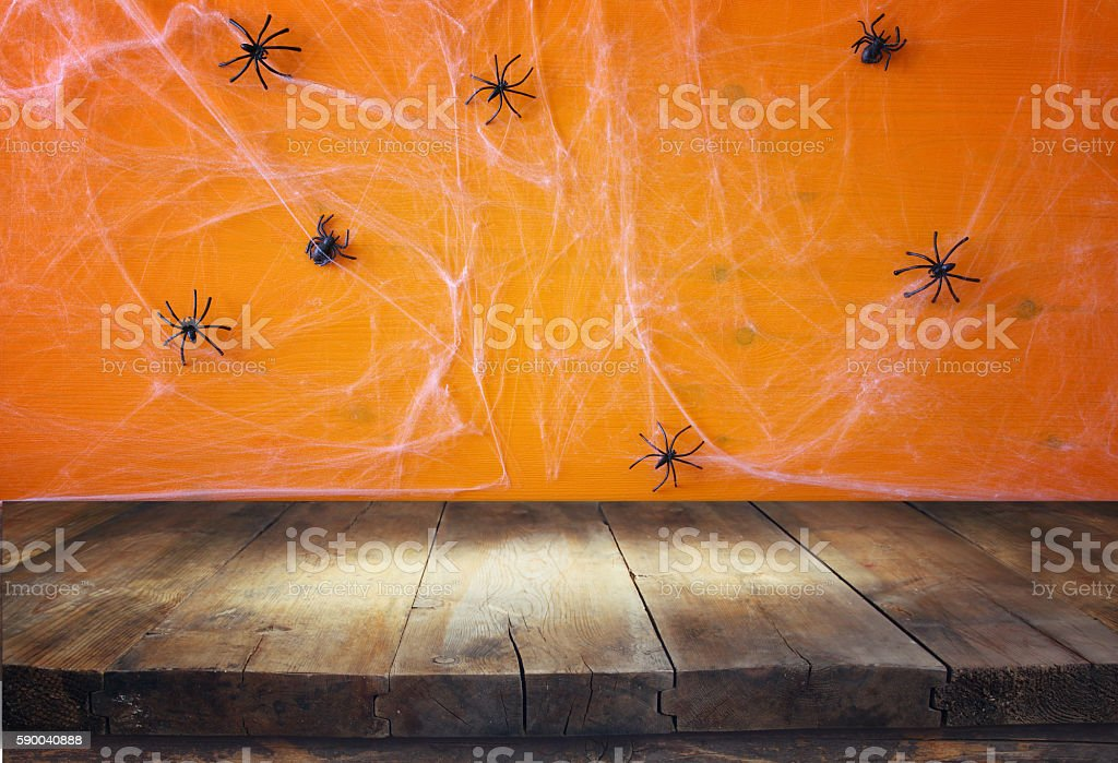 Empty rustic table in front of spider web background stock photo