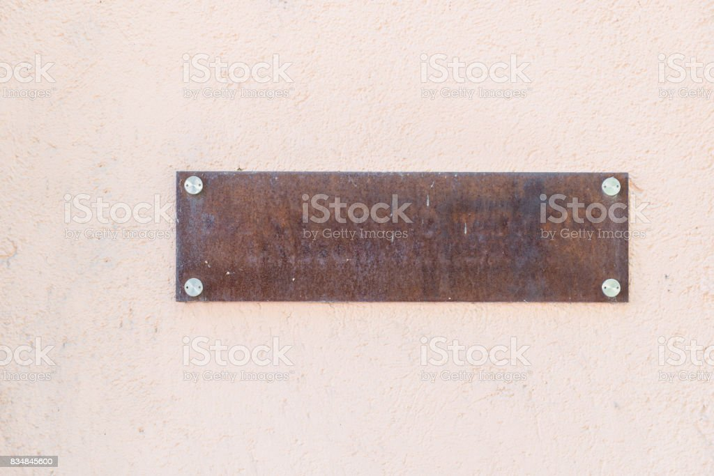 Empty rusty iron name plate stock photo