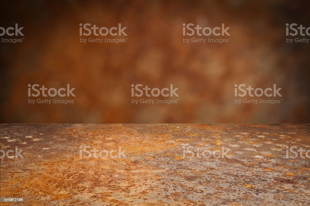 Empty rusty metal table with defocused vertical background stock photo