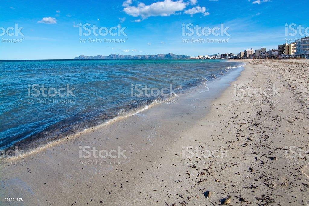 Empty sandy Mediterranean beach stock photo