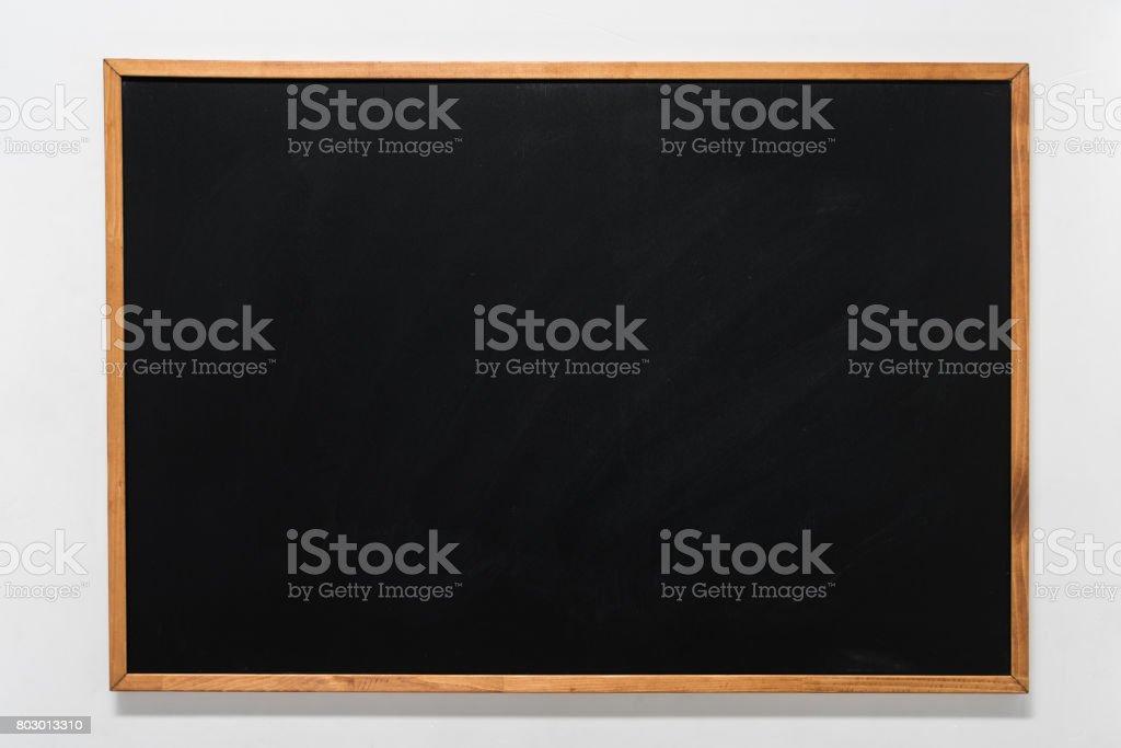 empty school blackboard in wooden frame with copy space stock photo