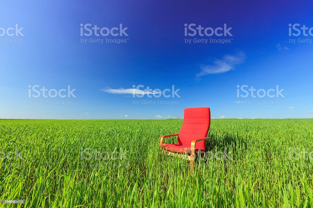 Empty seat in a green field royalty-free stock photo