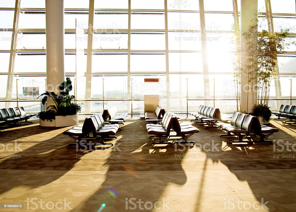 Empty seats in airport departure waiting area stock photo