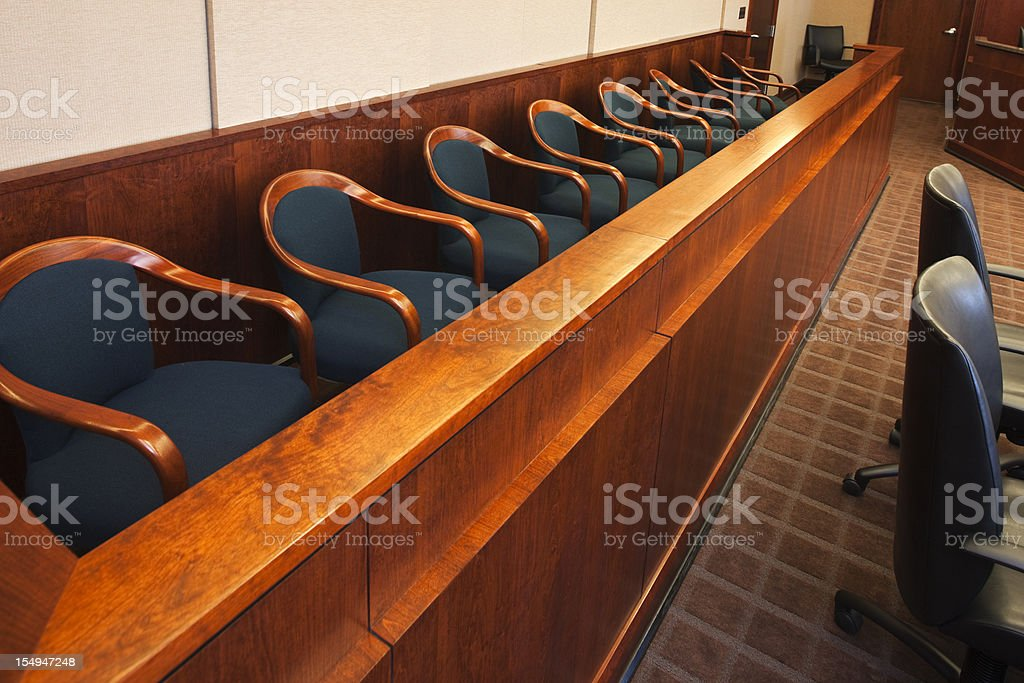 Empty seats in the jurors row in the court room stock photo