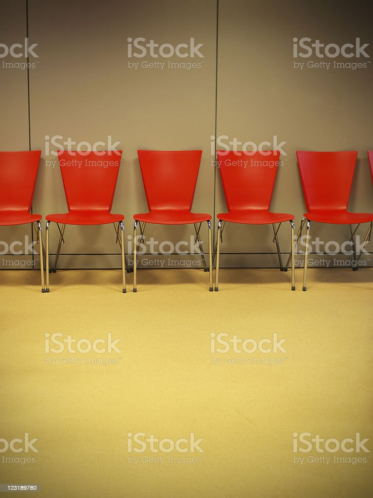 Empty seminar room with red chairs royalty-free stock photo