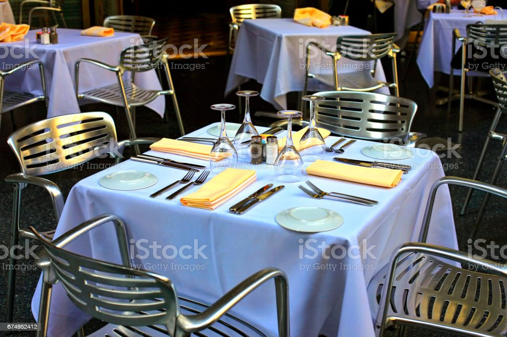 Empty set of glass and plates at restaurant stock photo