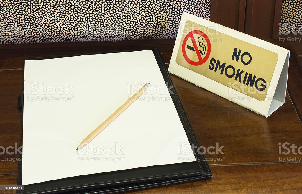 Empty sheet and Smoking sign stock photo