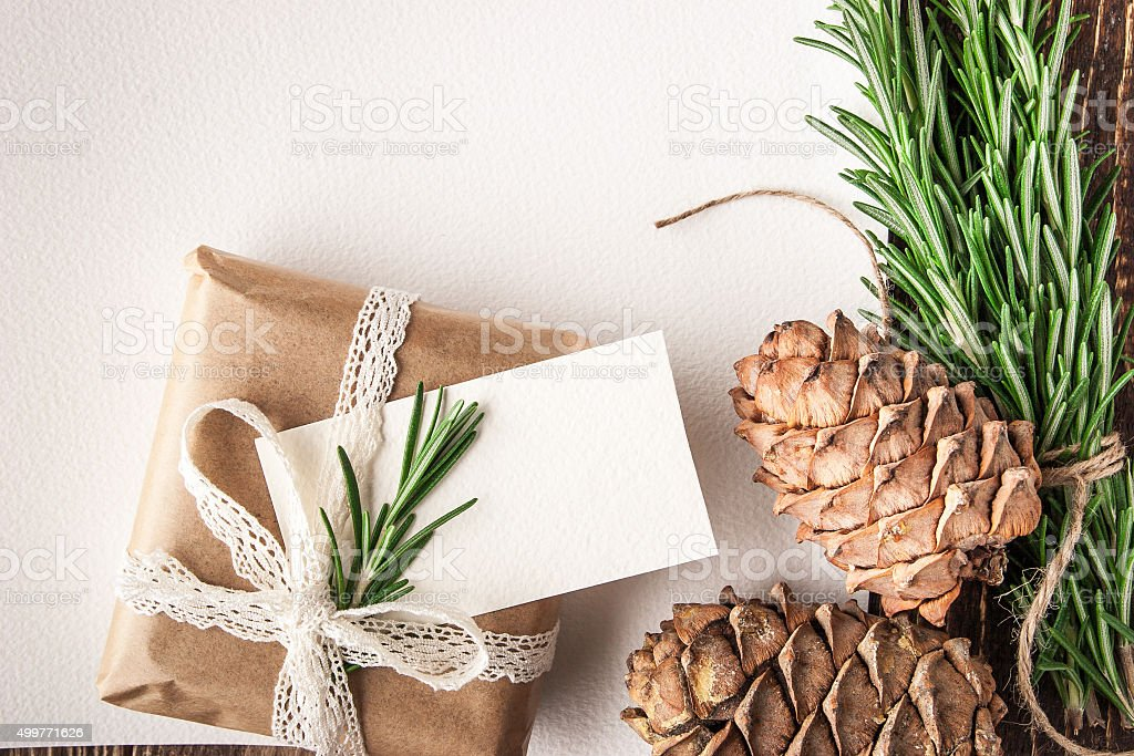 Empty sheet of paper with rosemary , cones and present stock photo