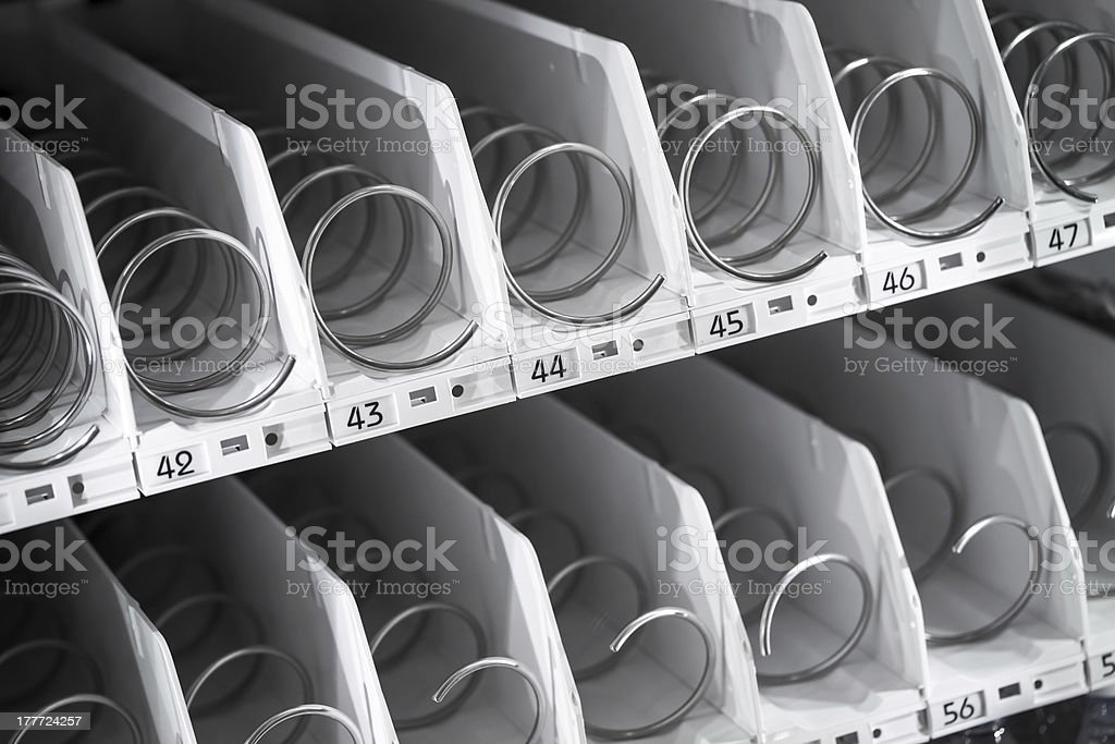 Empty shelf of office vending machine stock photo