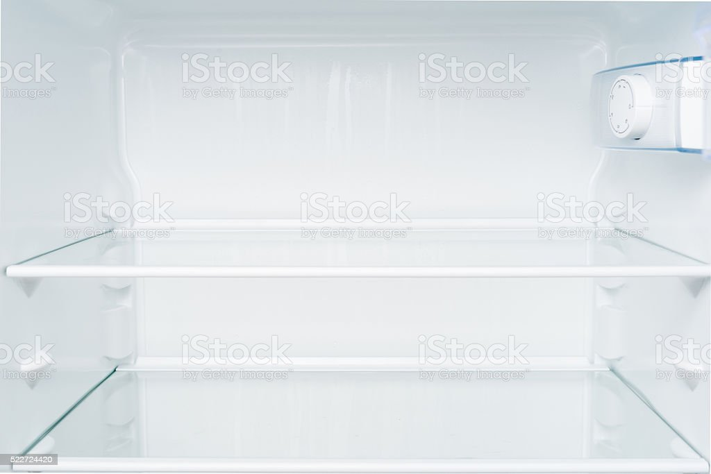 Empty shelves in refrigerator. stock photo