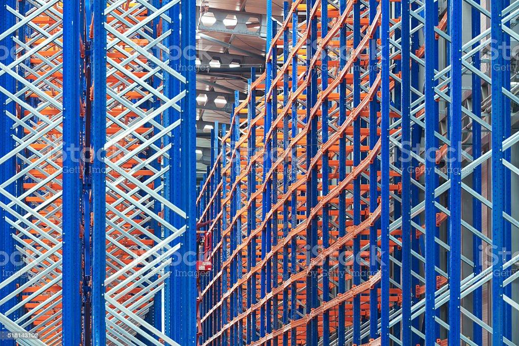 Empty shelves inside a warehouse stock photo