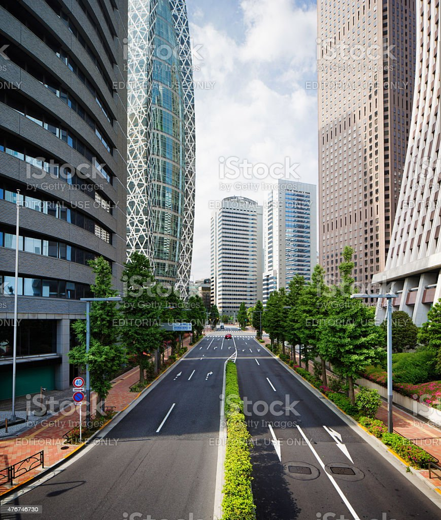 Empty Shinjuku Tokyo Japan street lined with skyscrapers stock photo