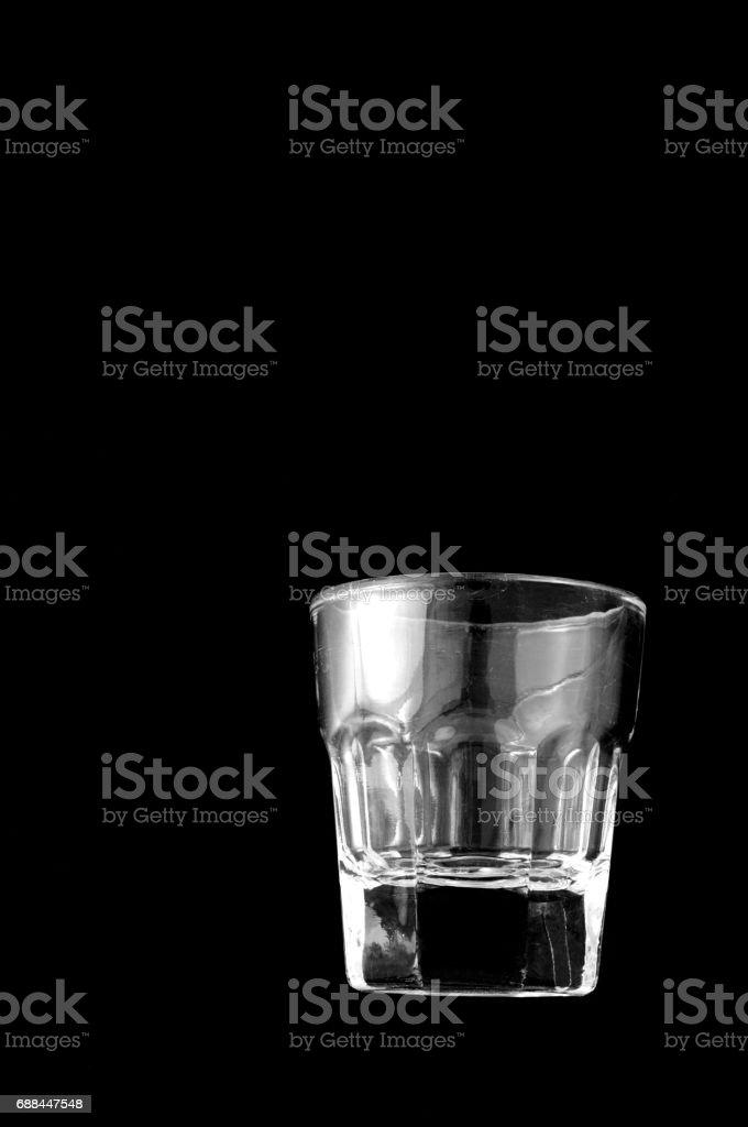Empty shooter glass on black background stock photo