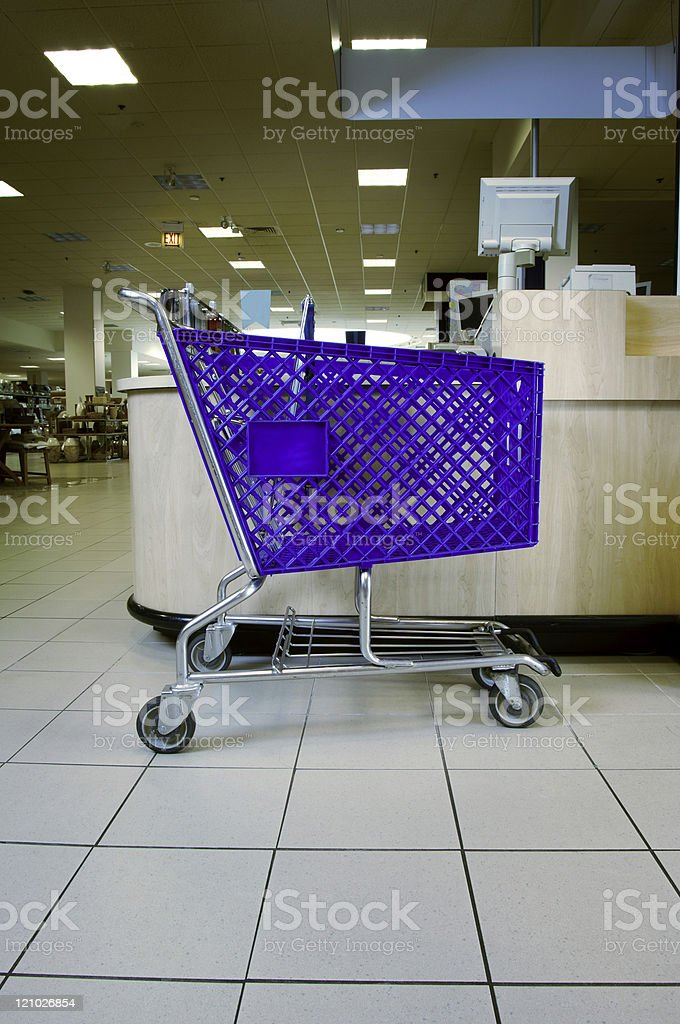 Empty shopping cart in store royalty-free stock photo