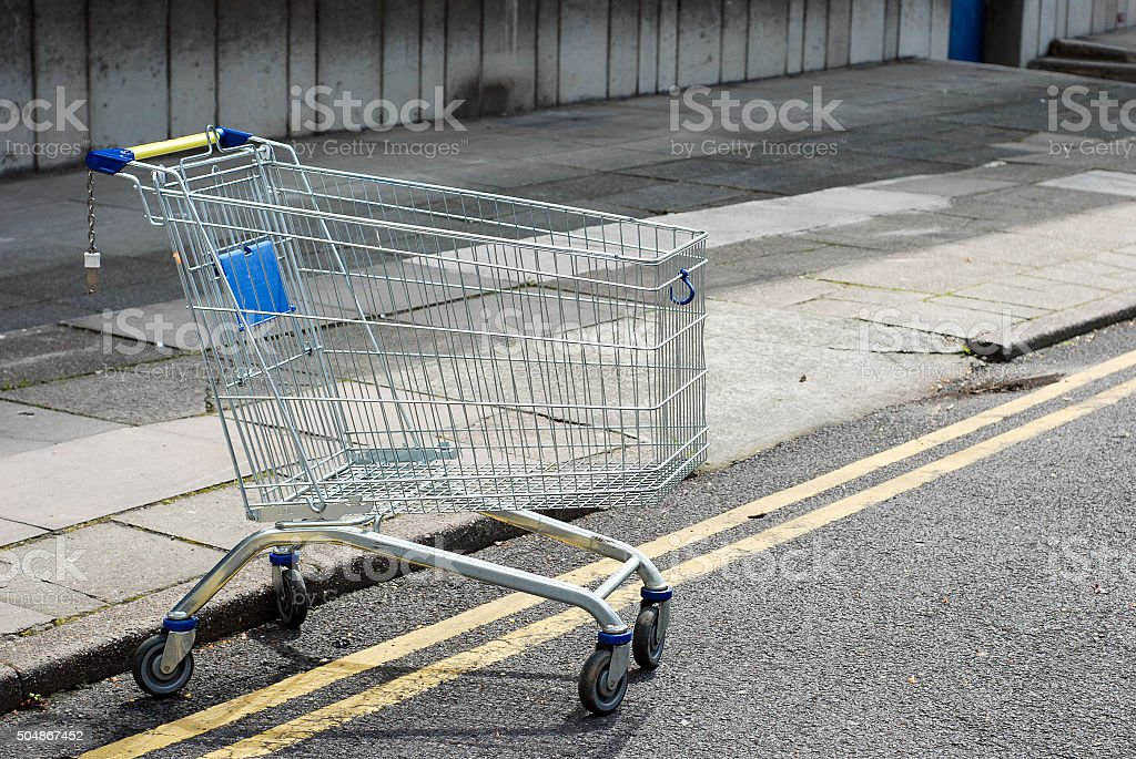 Empty shopping cart in the street stock photo