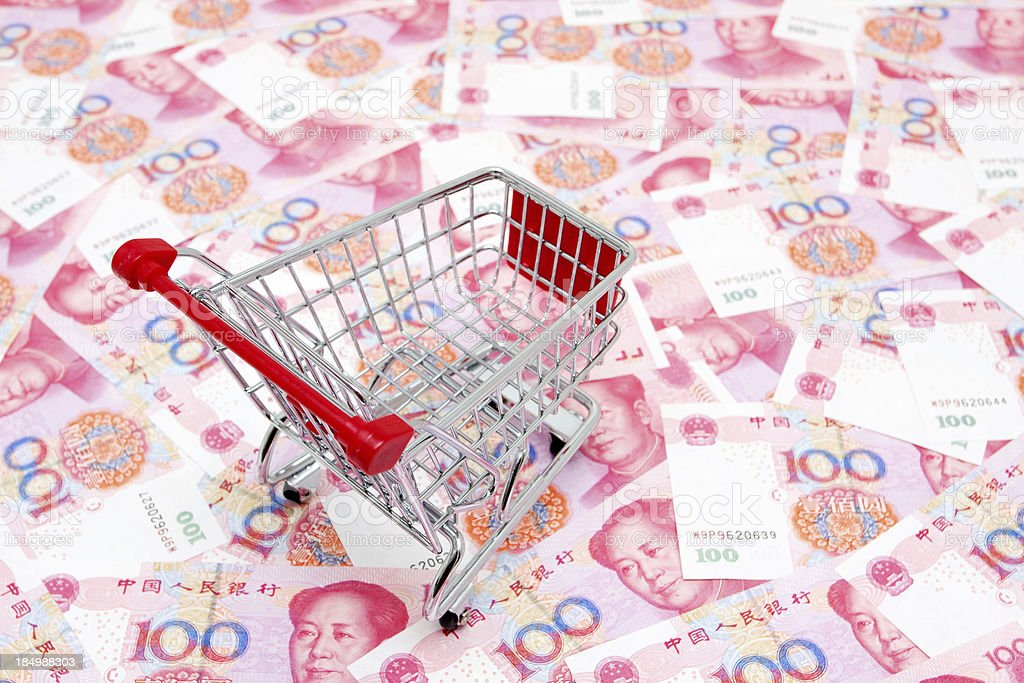 Empty shopping Cart on the renminbi background royalty-free stock photo