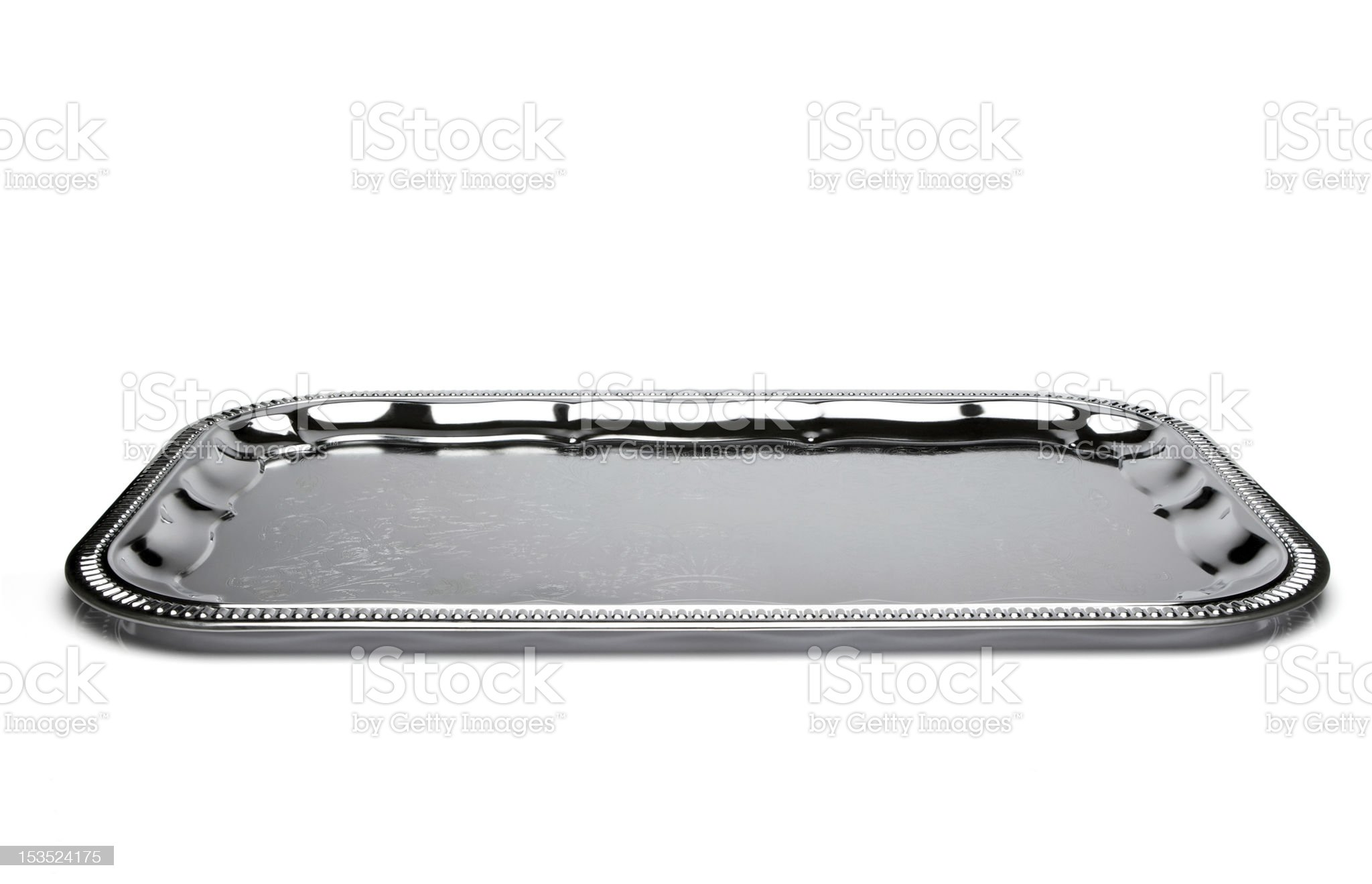Empty silver tray isolated on white royalty-free stock photo