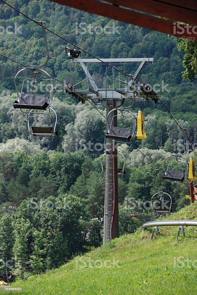 Empty ski lift chairs royalty-free stock photo