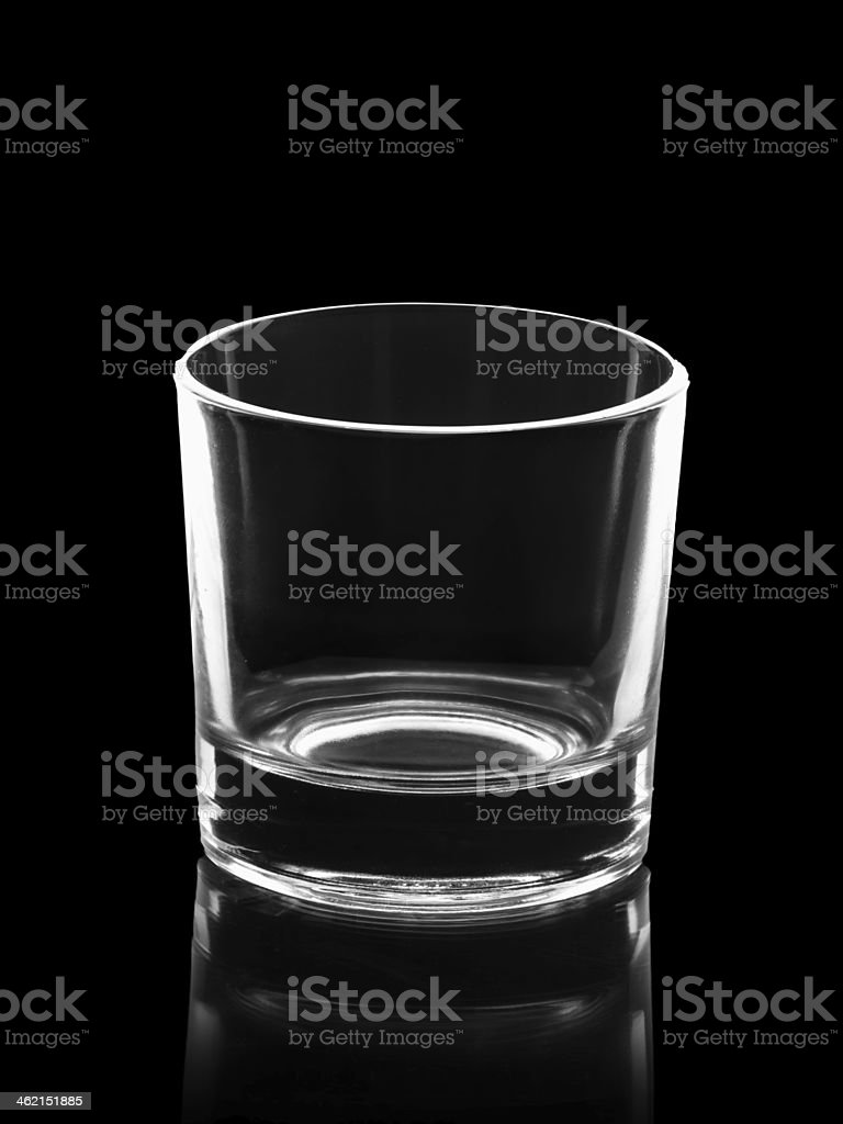empty small shot glass isolated on black royalty-free stock photo
