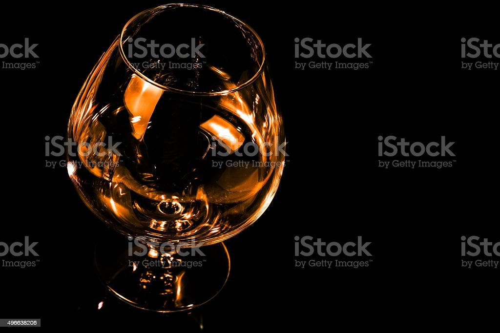 empty snifter of brandy in elegant typical cognac glass stock photo