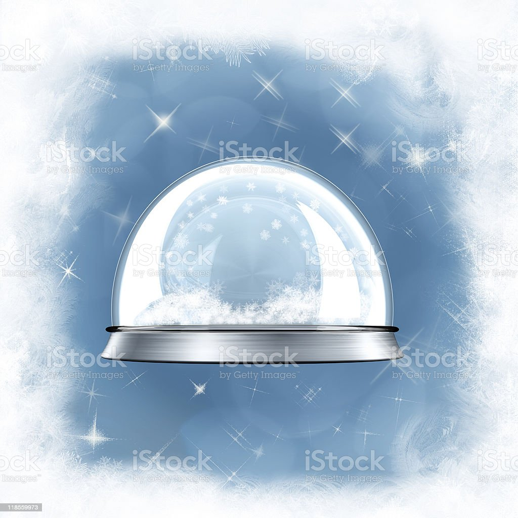 empty snow globe against a blue frosted background royalty-free stock photo