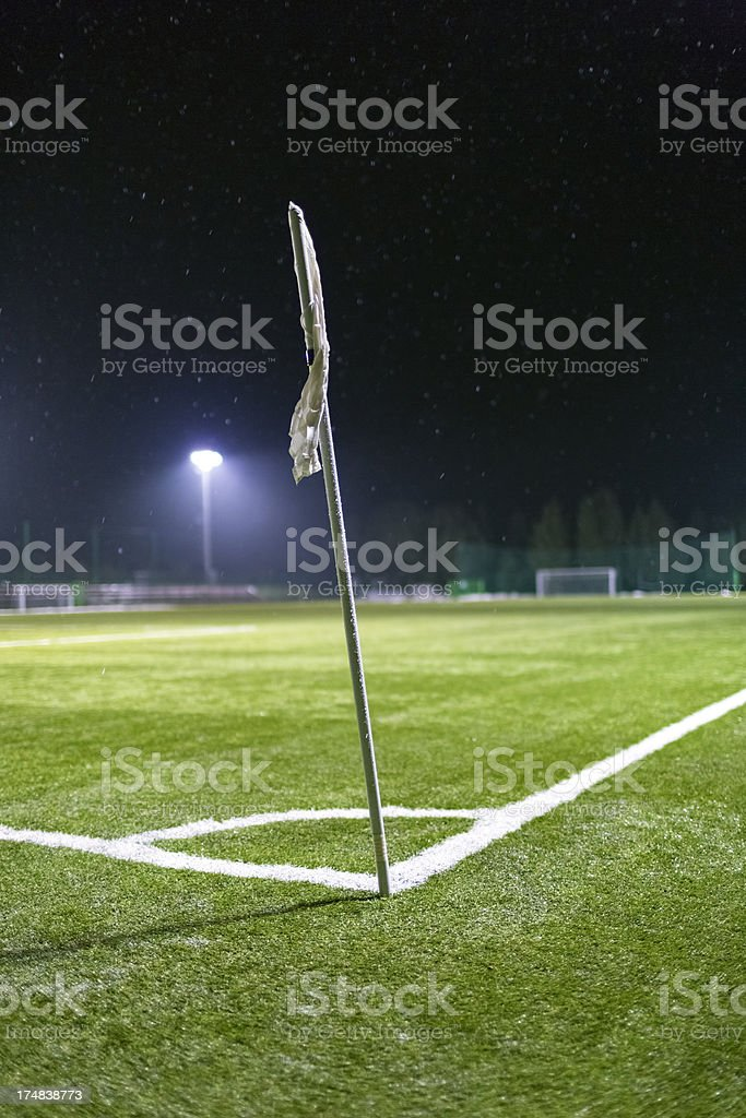 Empty soccer field corner on a snowy winter night royalty-free stock photo