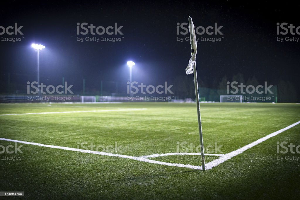 Empty soccer field corner on a snowy winter night royalty-free stock photo