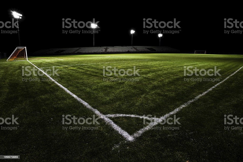 Empty soccer field with floodlights at night stock photo