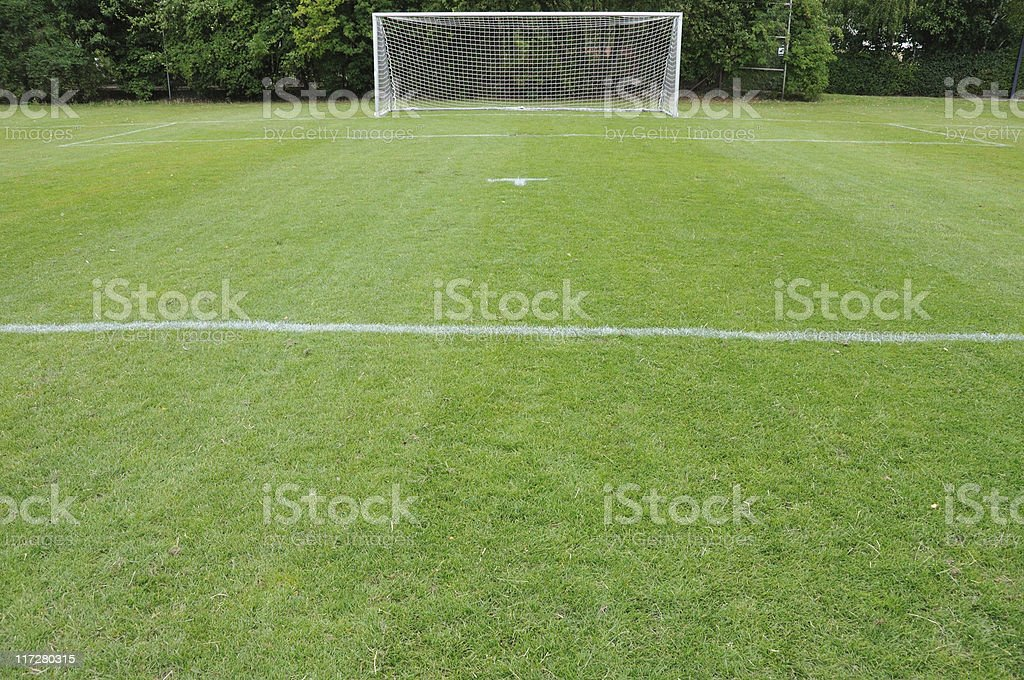 Empty soccer field with football goal stock photo