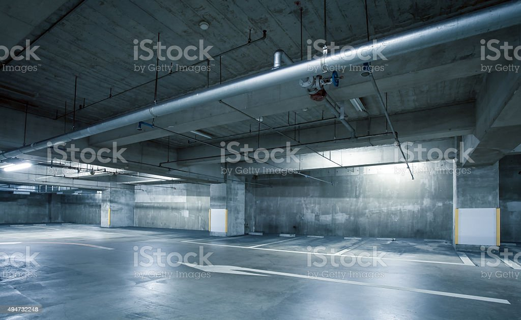 Empty space car park interior at night stock photo