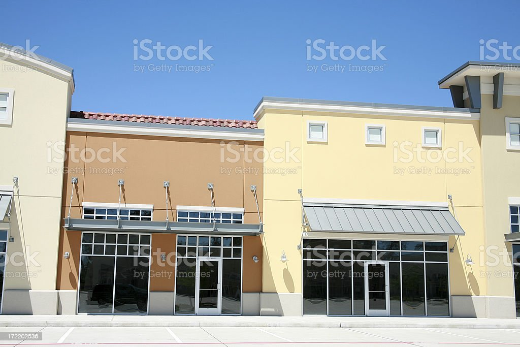 Empty spaces in strip mall, shopping center. Day. No people. royalty-free stock photo