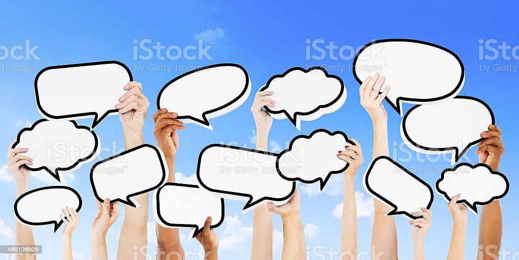 Empty Speech Bubbles Raised Outdoors stock photo