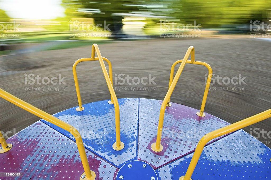 Empty Spinning Carousel stock photo