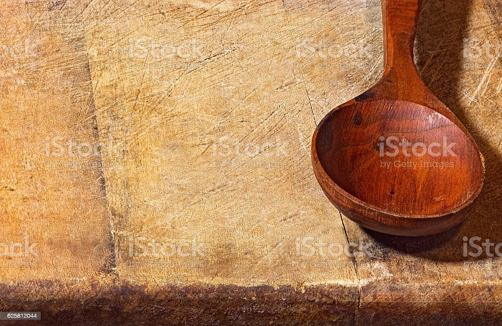 Empty spoon lying on a wooden background stock photo