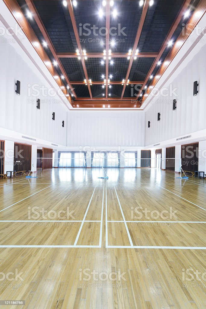 A empty sports court with white walls royalty-free stock photo