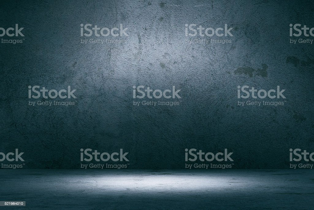 Empty spotlit concrete background stock photo