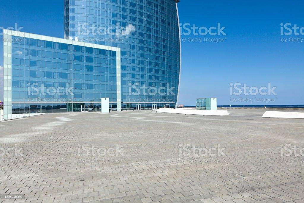 empty square and modern skyscraper stock photo