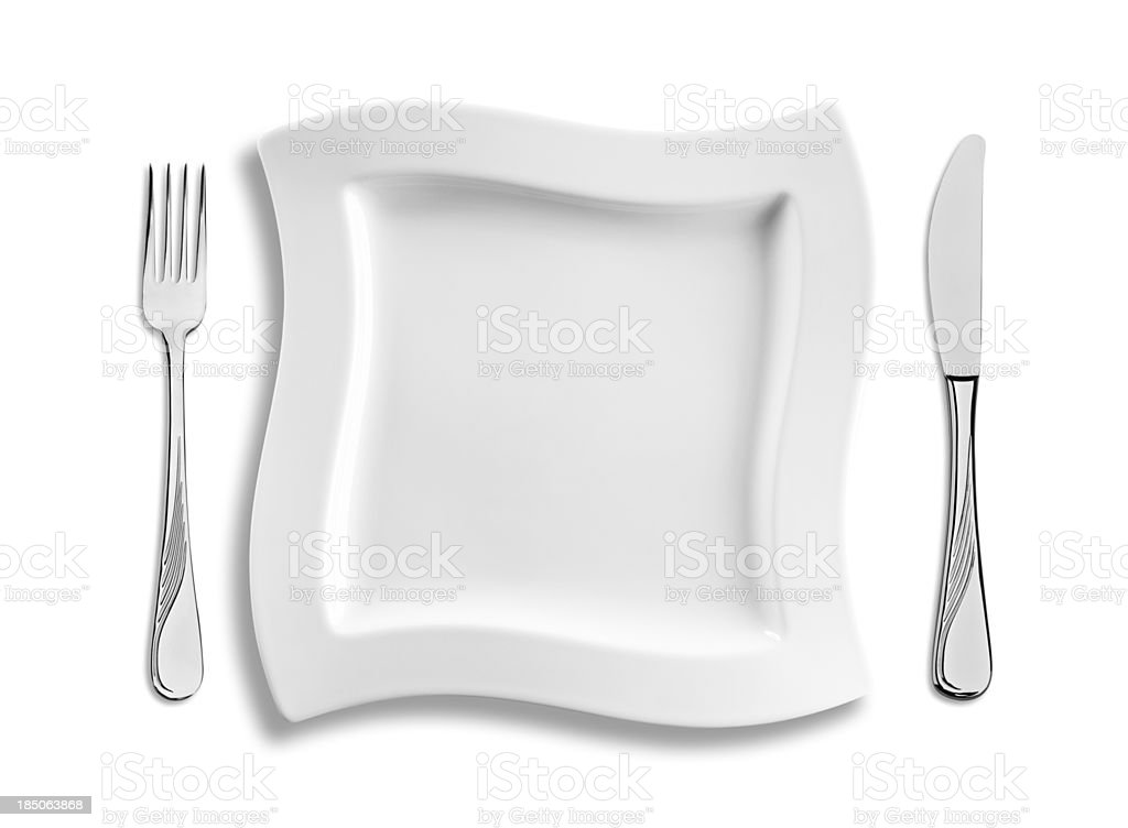 Empty square dinner plate with cutlery isolated on white background stock photo