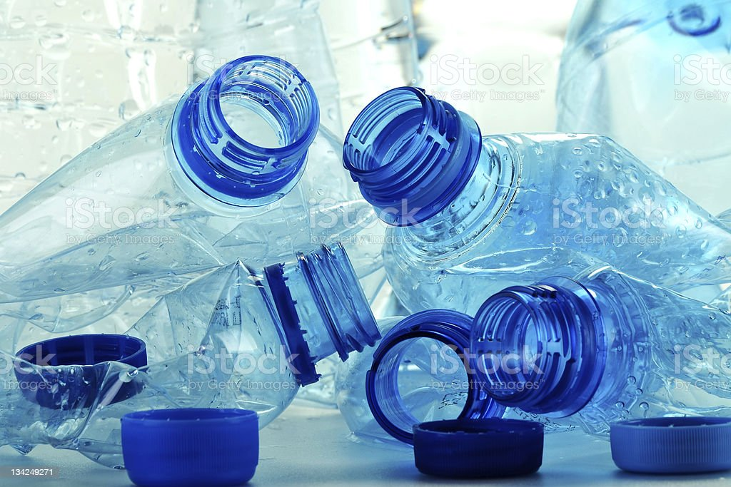 Empty squashed plastic bottles with no labels stock photo